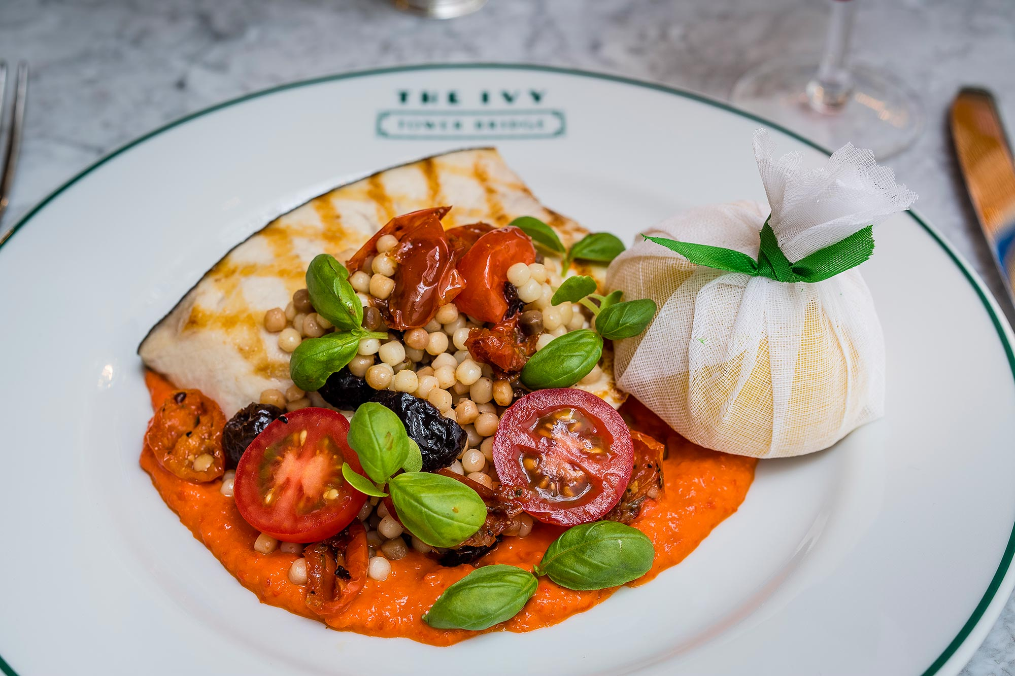 The Ivy Tower Bridge, London - Swordfish with red pepper sauce, tomatoes, fregola and pesto - The Ivy Tower Bridge