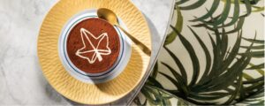 A hot drink with cocoa powder in the shape of a maple leaf at the Ivy Bar Brasserie Bath Spa