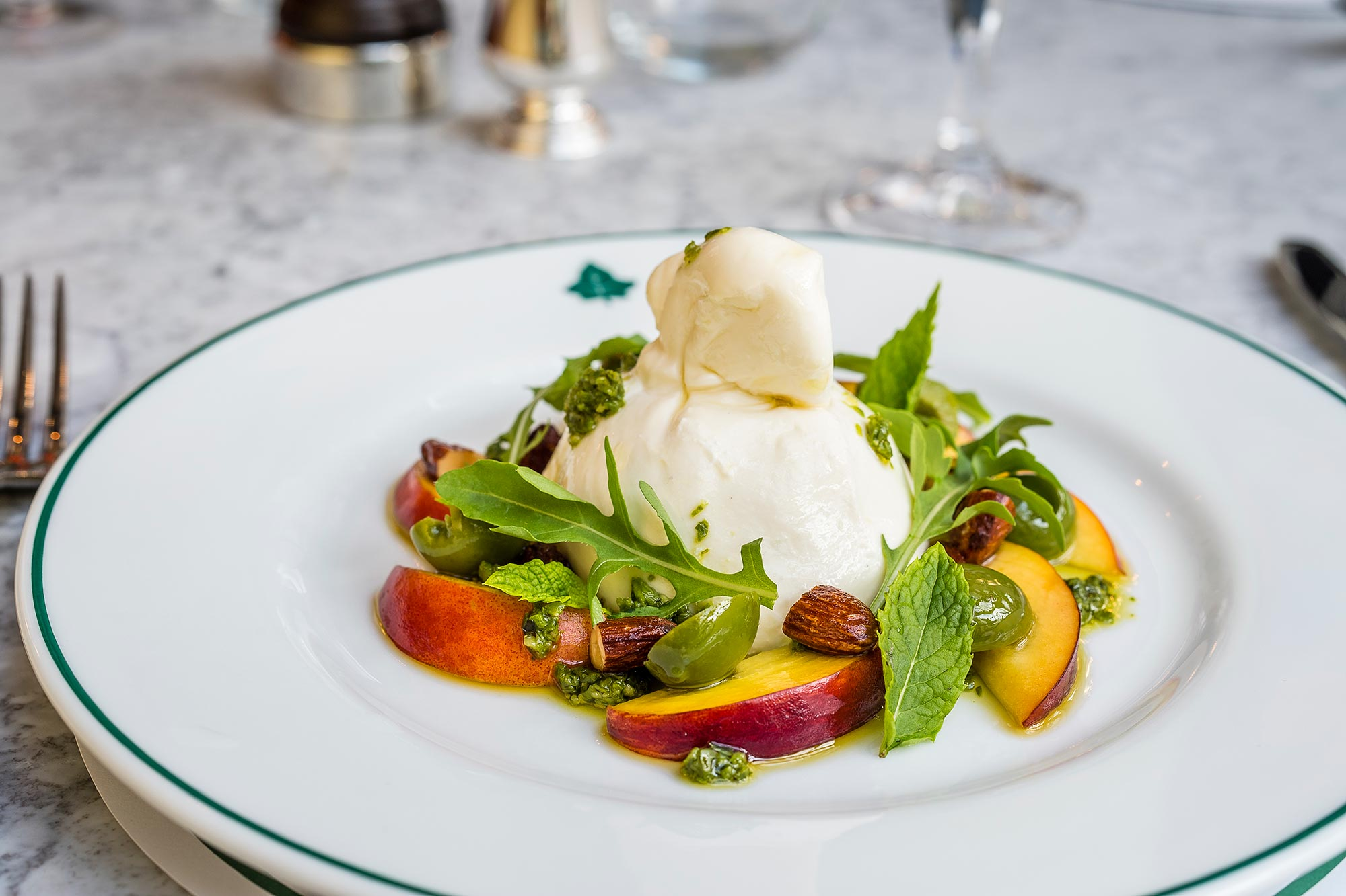 Burrata with Nocellara olive, pesto, rocke and almonds - The Ivy Kensington Brasserie - The Ivy Kensington Brasserie
