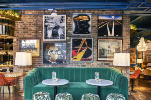 A green velvet sofa and picture wall at the Granary Square Brasserie, near Euston Station